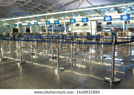 Coronavirus outbreak, empty check-in desks at the airport terminal due to pandemic of coronavirus and airlines suspended flights.
