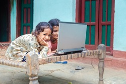 Coronavirus Outbreak. Lockdown and school closures. Indian school kids girl watching online education classes at home. COVID-19 pandemic forces children online learning.