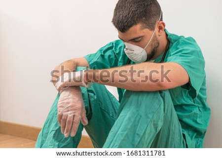 Coronavirus pandemic . Tired exhausted doctor after long shift fighting against Coronavirus (2019-nCoV) at hospital clinic. Global pandemic outbreak SARS-CoV-2 worldwide virus.