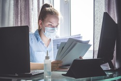 Coronavirus. Quarantine. Online training education and freelance work. Computer, laptop and girl studying remotely. Coronavirus pandemic  in the world. Closing schools