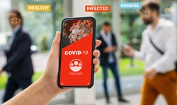coronavirus tracking app on a mobile smartphone. Close up of woman tracking crowd of people in a smartphone screen application. Hand holding smart device. Mockup website. covid-19 corona virus tracker