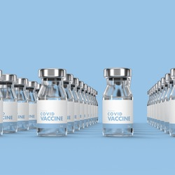 Coronavirus vaccine bottles over lightblue background