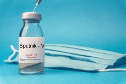 Coronavirus vaccine concept and background. New vaccine sputnik-v isolated on blue background. Covid-19, 2019-nCov pandemic.