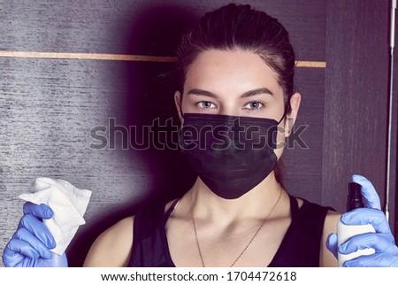 Coronavirus. Woman in quarantine for coronavirus wearing protective mask and plastic gloves. Stockfoto ©
