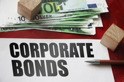 CORPORATE BONDS written on page, many 100 euro bills nd a pen. Business concept.
