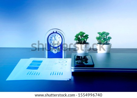 Corporate Business infograph checking sheet along with Laptop and Alarm Watch, Marketing & Finance Photo #1554996740