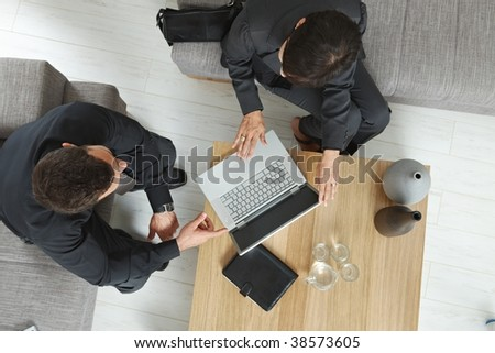 Corporate business people working together on meeting overhead view.