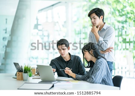 Corporate business team discussing together in conference room during meeting at office. Teamwork and ideas or brainstorming meeting workplace concept.