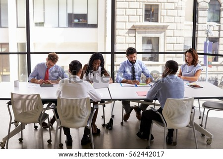 Corporate business team working in a modern open plan office