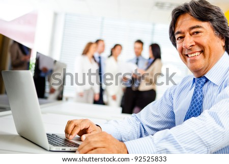Corporate business worker at the office with a laptop