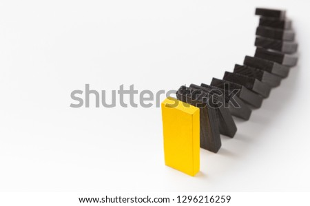 Corporate culture and discipline at work. Black wooden blocks following yellow leading one in strict order on white background, panorama, copy space #1296216259