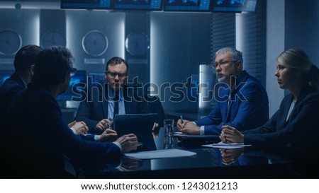 Corporate Executive Debates with His Board of Directors Colleague During Meeting. Serious Business People: Problem Solving, Negotiating and Strategizing in the Conference Room.