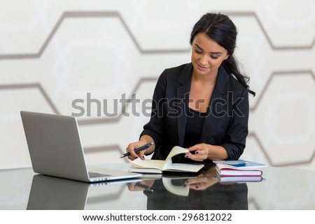 Corporate female busy writing working at the workplace office reflection table modern background