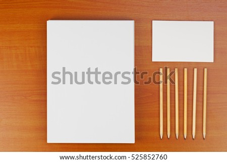 Corporate ID set on wood background for presentations and portfolios. #525852760