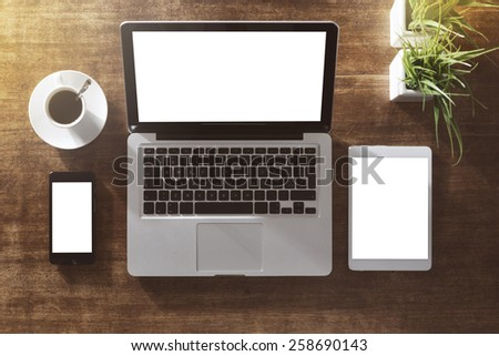 Corporate identity mock up on an hardwood desk with laptop, tablet, smartphone and a cup of coffee #258690143