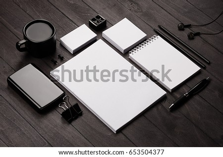 Corporate identity template,  blank stationery set with coffee and earphone on black stylish wood background. Mock up for branding, business presentations and portfolios.