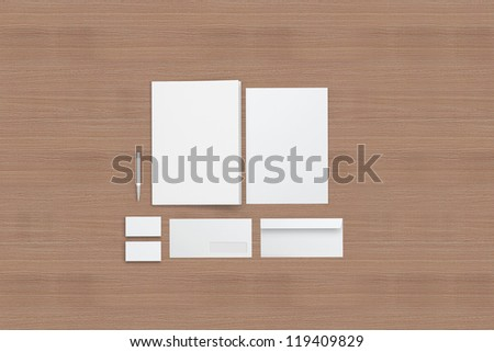 Corporate identity templates / templates:blank, business cards, envelope, pen, folder /  On wood background with soft shadows