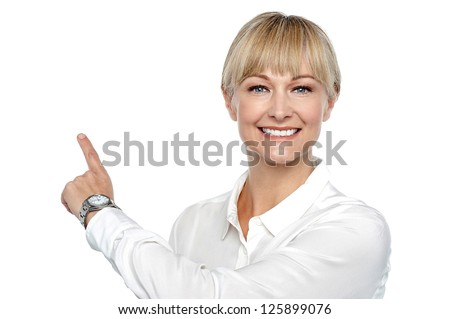 Corporate lady pointing backwards, copy space concept.