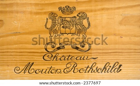 corporate logo of the famous winery chateau mouton-rothschild - on a wooden wine box