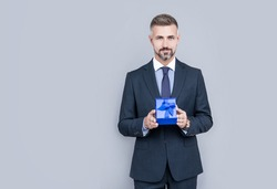 corporate present. womens day. successful boss share giftbox. handsome man prepare for romance date. business reward. occasion greeting. boxing day. businessman showing birthday gift box. copy space.