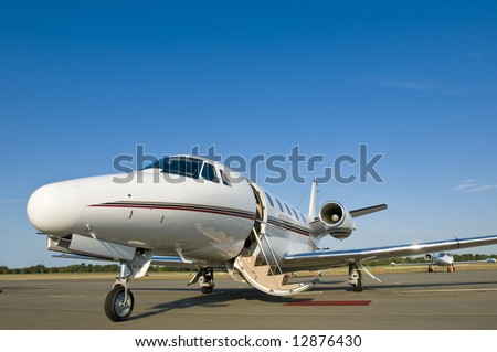 Corporate private luxury jet at airport door open blue sky