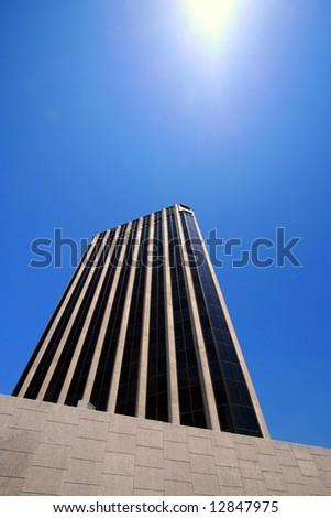 corporate skyscraper perspective against blue sky