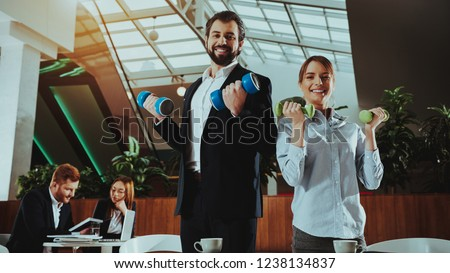 Corporate Sport Lifestyle. Healthcare of Business People. Office Workers Working with Dumbbells. Workers doing Fitness Exercises. Yoga Practice. Employee Man Smiling to Healthy Woman. #1238134837