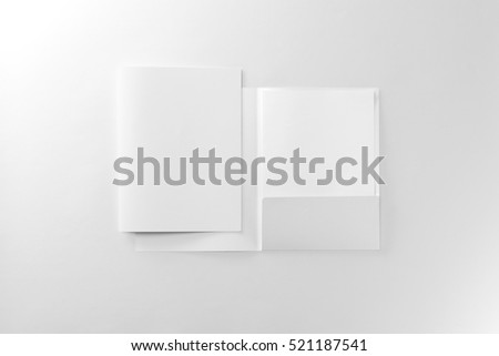 Corporate stationery set mockup. Two presentation folders and letterhead at white textured paper background.  #521187541