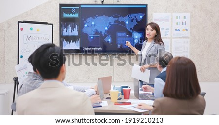 corporate teamwork - young asian busineswoman lead group of business startup team in strategic meeting presentation