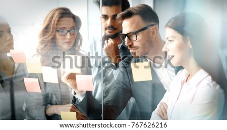 Corporate teamworking colleagues in modern office