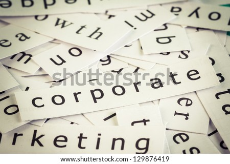 Corporate topic, cut paper on the top of others word