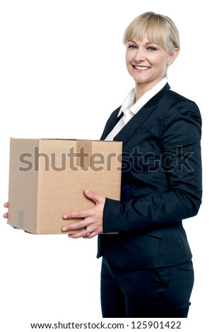 Corporate woman with a cardboard box in hand. Shifting her office.
