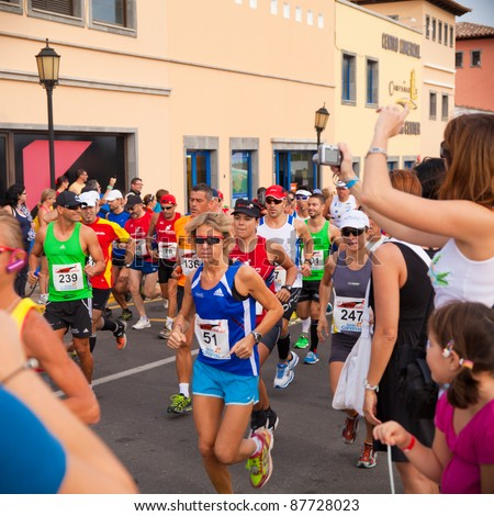 CORRALEJO - OCTOBER 30:  Runners start the race at IIIrd international Fuerteventura half-marathon 30 October, 2011 in Corralejo, Fuerteventura, Spain