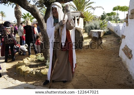 CORRALES, HUELVA, SPAIN - DECEMBER 23: The Living Crib of Corrales celebrations, an undefined woman at work acting at reenactment of the Living Nativity, on December 23, 2012 in Corrales, Spain