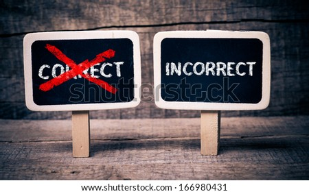 Correct or incorrect. Correct or incorrect written on small blackboards on wooden background
