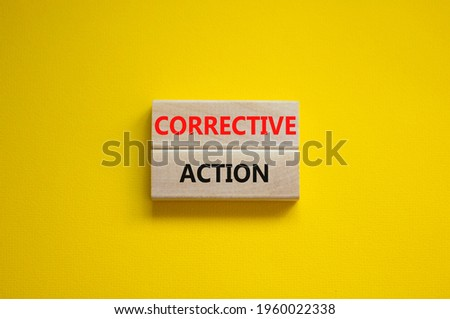 Corrective action symbol. Wooden blocks with words 'Corrective action' on beautiful yellow background. Business and Corrective action concept. Copy space. Stockfoto ©