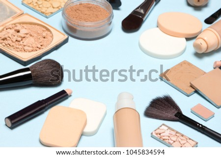 Shutterstock Corrective makeup set with copy space. Concealers, primer, foundation with correcting, highlighting, shimmer powder, make-up brushes and sponges