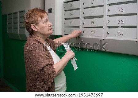Correspondence received by mail. An elderly woman looks at the bill. A small pension in Russia and you need to save a person.