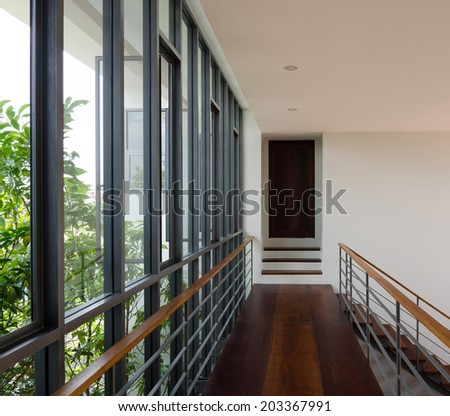 Corridor and modern staircase with a nice wooden finish