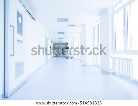 Corridor in hospital with carts illuminated by sunlight #514581823