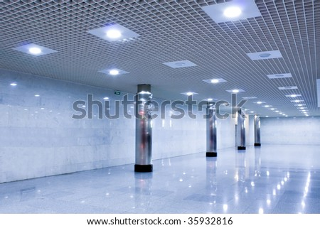 corridor in metro station with wide columns - stock photo