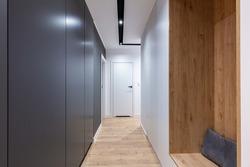Corridor in modern design apartment with closet and seat. Interior design