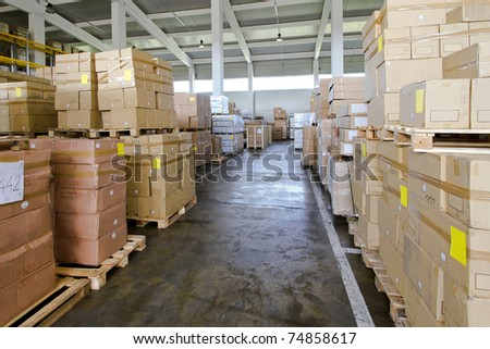 Corridor in warehouse with lot of boxes