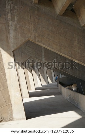 corridor of concrete beams with natural sunlight. special architectural beam frame.  #1237912036
