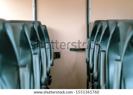 Corridor, passage between the seats. Rows of Seats . Access to the toilet, fire exit #1551361760