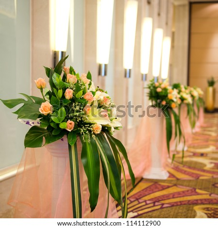 corridor with row of flowers in a Chinese hotel.