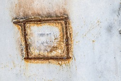 Corroded light blue metal background. Rusty metal wall. Rusty metal background with rust spots. . There are rust stains on the metal surface.