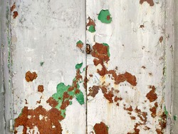 Corroded metal background. Rusted grey painted metal wall. Rusty metal background with streaks of rust. Rust stains. The metal surface rusted spots. Rystycorrosion.
