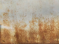 Corroded metal background. Rusted painted metal wall. Rusty metal background with streaks of rust. Rust stains. The metal surface rusted spots. Rystycorrosion.