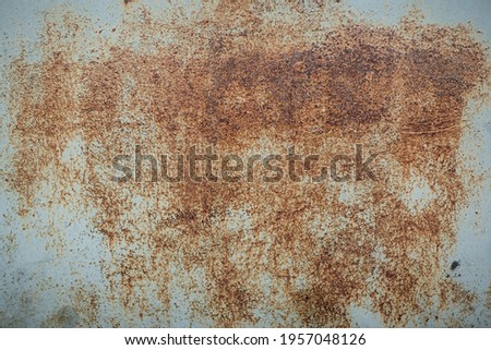 Corroded metal background. Rusted painted metal wall. Rusty metal background with streaks of rust. Rust stains. The metal surface rusted spots. Rystycorrosion. Stockfoto ©